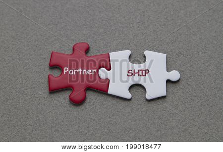 Partnership word written on red and white puzzle piece.