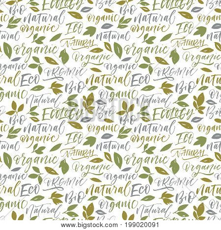 Seamless green eco pattern. Set of eco phrases : ecology natural bio eco organic. Leaves ornament. Ink illustration. Hand drawn ornament for wrapping paper.