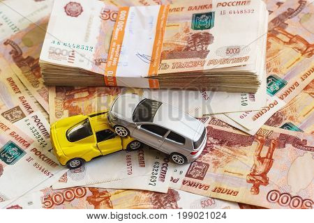 The Concept Of Getting Insurance Premium After Car Accident: Two Cars And A Stack Of Russian Rubles