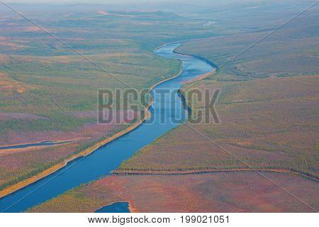 Siberian taiga river Kochechum view from the helicopter. Krasnoyarsk region Russia
