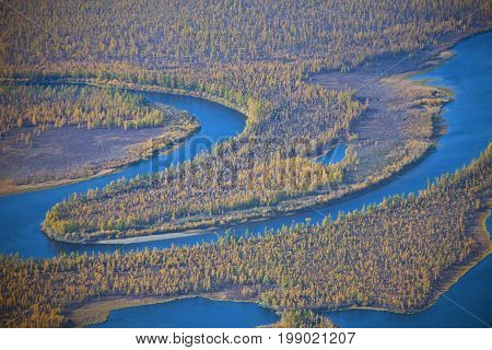 Meanders of the river Moierokan and Siberian taiga in the fall from the helicopter. Evenkiya Krasnoyarsk region Russia