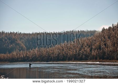 Morning with frost and fog on the Siberian river in the fall. Riverbed Moiyerokhan in Evenkia in September during the rafting and fishing Krasnoyarsk region Russia
