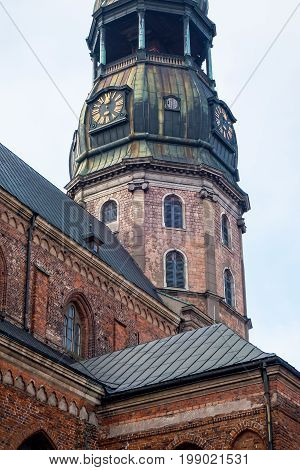 Tower clock of the famous St. Peter Church, Old town, Riga, Latvia. Saint Peters Lutheran church in Riga, Latvia