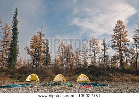 Yellow tent on the banks of the Siberian taiga rivers. Evenkiya Krasnoyarsk region Russia