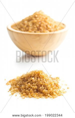 Brown cane sugar isolated on white background. Sweet brown sugar.