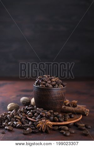 coffe beens with spices. Ingredients for aroma coffe anise, cardamon, cinnamon,