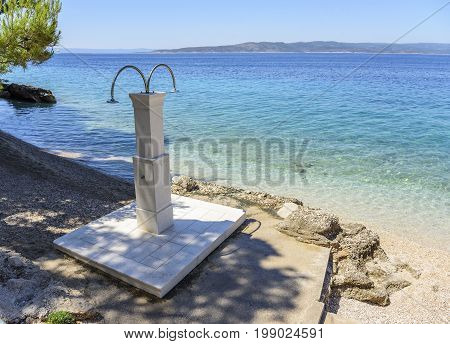 Shower on the beach. Open shower for washing off the salt after bathing.