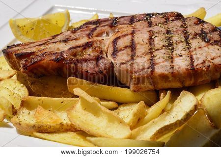 Mixed Grilled Meat And Vegetables - Mixed Grilled Meat And Sausages On Wooden Board. Assorted Delici