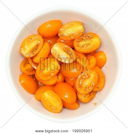 Sun Gold Cherry Tomatoes halved with salt and pepper.