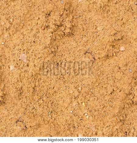 seamless wet yellow sand texture. beach background.