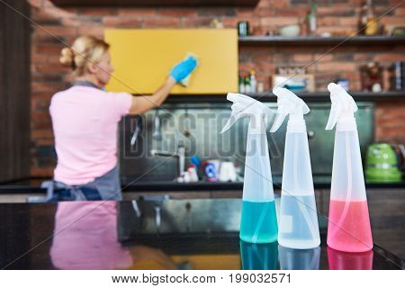 Cleaning service. woman clean kitchen