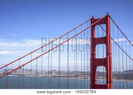 First tower of the Golden Gate Bridge and San Francisco downtown in the sunny day