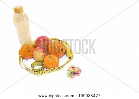 Still life composed of fruits water cereals and centimeter. White background. Concept of health.