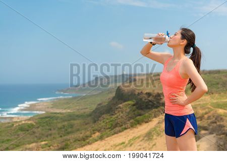 Young Athlete Jogger On Hill Top Holding Bottle