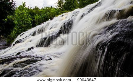 Beautiful Michigan Waterfall Background. Bond Falls is a beautiful and easily accessible waterfall in northern Michigan. These factors and it's sheer size make it a very popular tourist destination.