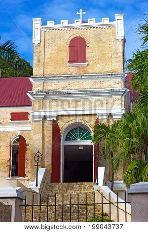 Lutheran Church on St Thomas Island USVI. Seventeenth century church with ornate tower and palm trees.