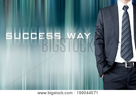 SUCCESS WAY text on blur background with standing businessman