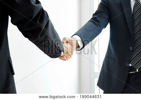 Handshake of businessmen - success dealing greeting & business partner concepts