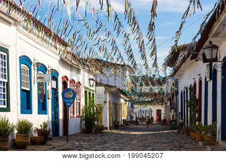 Typical Cobblestone Street With Colonial Buildings In Historic Town Paraty On The Time Of Carnival,