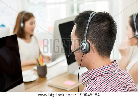 Asian telemarketing customer service agent team call center job concept