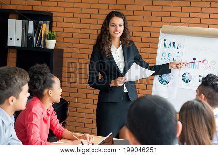 Business woman leader conducting company sales presentation in the meeting
