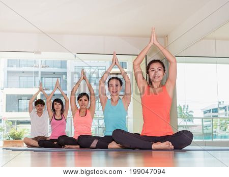 Yoga Class In Studio Room,group Of People Doing Namaste Pose With Clam Relax Emotion,meditation Pose