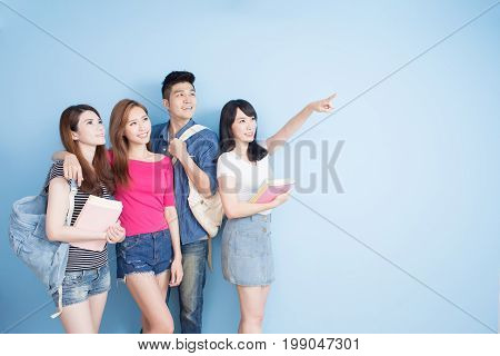 happy group student show something on the blue background
