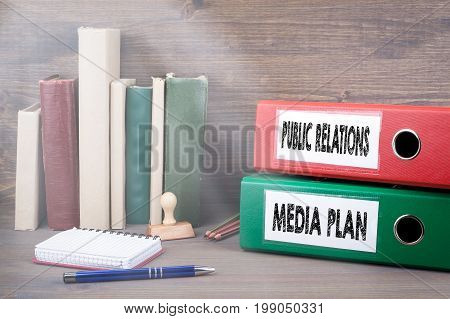 Media Plan and Public Relations. Binders on desk in the office. Business background.
