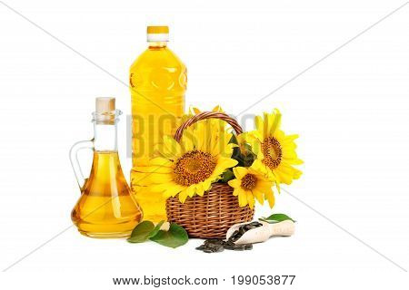 Beautiful flowers of sunflowers in a rustic basket and sunflower oil on a white background. An isolated object.