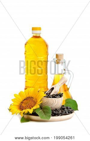 Beautiful flower, sunflower, sunflower oil and roasted sunflower seeds on a white background. An isolated object.