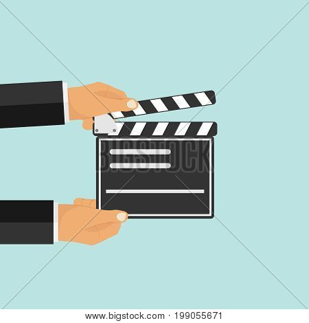 Production of the film. Hands hold the production of the film. Flat design vector illustration vector.
