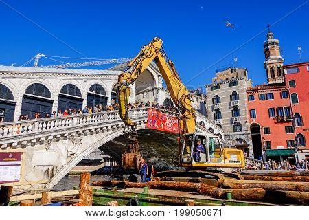 Venice, Italy - March 29: Construction site by the Grande Canal near Rialto Bridge in Venice, Italy,in March 2015.