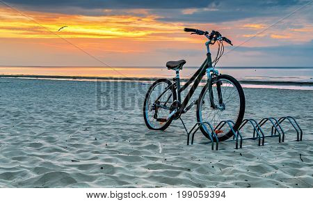 Bicycle at sandy beach of Jurmala - famous public domain resort in Latvia, Europe