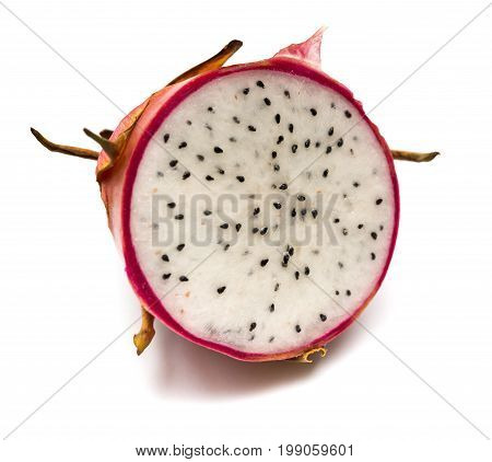 half of fresh dragon fruit on a white background