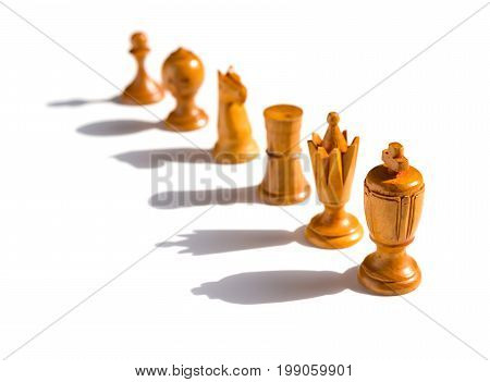 brown chesses line up on a white background with shadows
