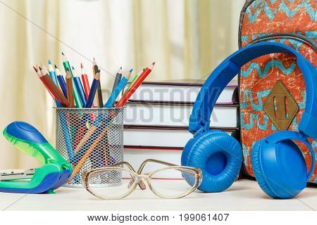 School Backpack With School Supplies. Books, Stand For Pencils With Color Pencils, Stapler, Glasses