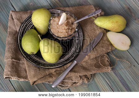 Pears and pear puree on a wooden table closeup