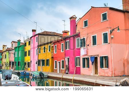 Venice landmark, Burano island with colorful houses and boats, Italy