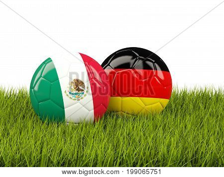 Mexico And Germany Soccer Balls On Grass