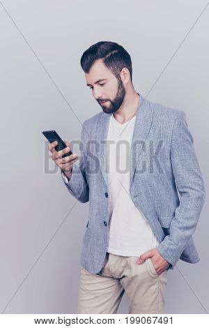 Young Cheerful Brunete Bearded Lawyer Is Standing On The Pure Light Blue Background And Smiling, Rea