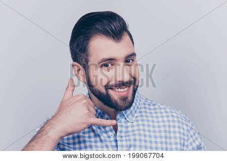 Cheerful Brunet Bearded Freelancer Is Smiling, Showing Call Sign, Wearing Casual Smart, Standing On