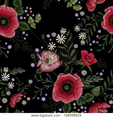 Embroidery traditional seamless pattern with red poppies and chamomiles. Vector embroidered floral patch with flowers for clothing design.