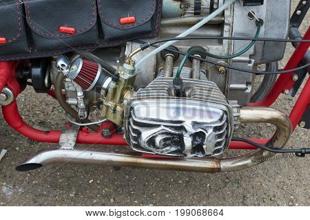 CHERNIVTSI, UKRAINE - JULY 22, 2017: Red Motorcycle Parts, detail of motorcycle, engine Gas tank frame seat at the festival Moto-picnic Retrodrom 2017