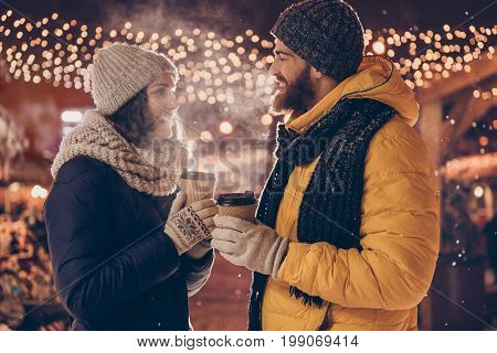 Christmas Time Together! Young Happy Couple Is Having A Walk In A Winter Park On A Christmas Eve, En