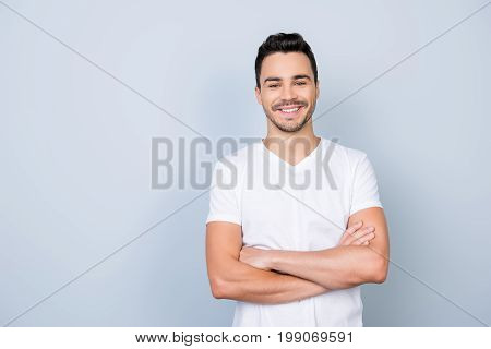 Success Concept. Excited Young Stylish Bearded Brunet  Guy In White T Shirt Standing On Light Backgr