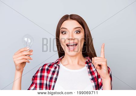 Eureka! Have An Idea! Success Concept. Young Cute Female Student Is Standing With A Lamp In Her Hand