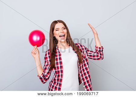Birthday Girl Here! Cheerful Funky Young Hipster In Casual Wear Is Holding Red Balloon On Grey Backg