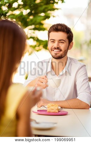 Close Up Cropped Portrait Of Young Handsome Brunet Cheerful Guy On A Date In Cafe Outdoors, Smiling,