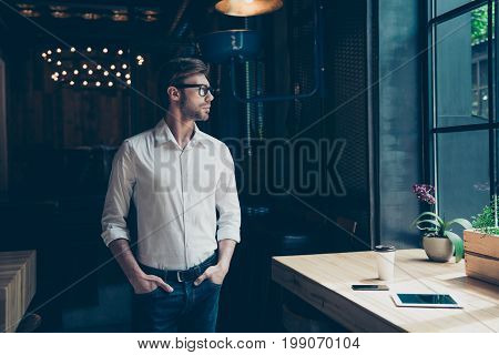 Young Well Dressed Entrepreneur At The Modern Office Is Looking At The Window, Well Dressed, Serious