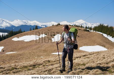 Full Length Shot Of A Man With Backpack Walking Mountains Enjoying The View Copyspace Nature Travell